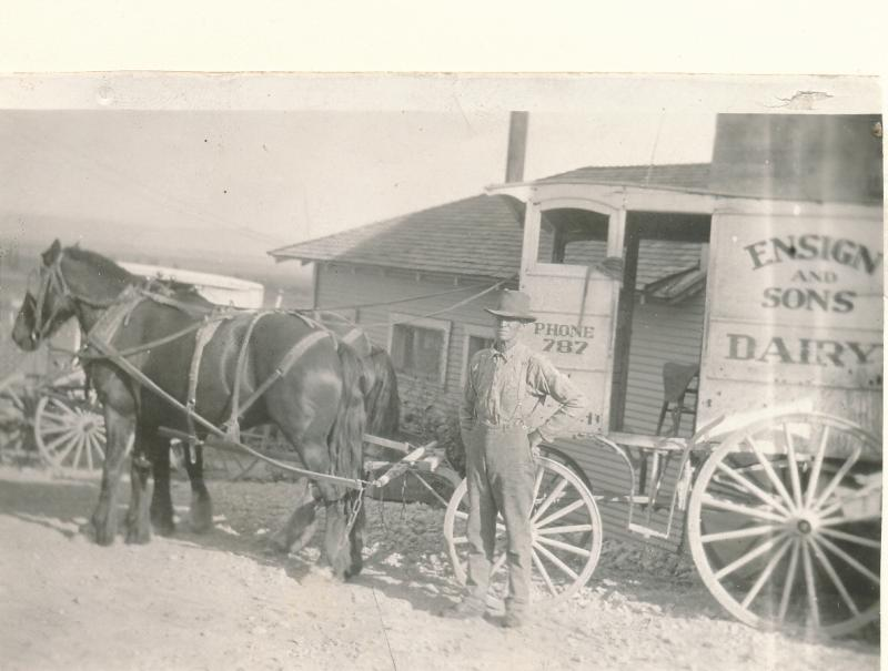 Wesley Ensign with his milk wagon